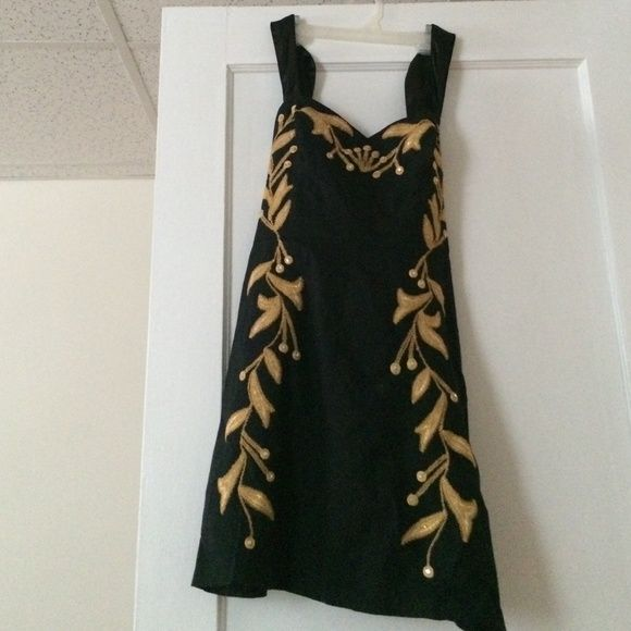 Free people Dress Black dress with gold and sequined design. Silk straps that can tie around the back. Zips up side Free People Dresses