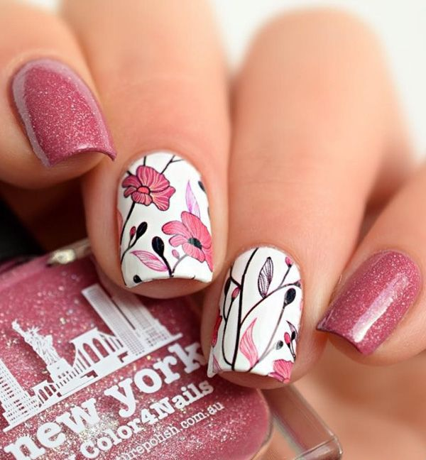 Another pretty in pink spring nail art design. Using white polis as base color as well as pink sheer color with glitters, your nails will look absolutely gorgeous. Add pretty flower details on top and everything is perfect.