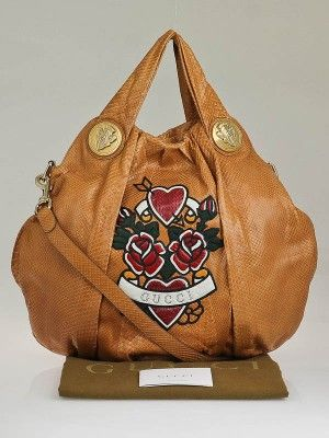 4e6b63d0f57 The Gucci Beige Python Tattoo Hearts UNICEF Hysteria Large Top Handle Bag s  big enough for all that we need to carry. This sleek bag features exotic  tan ...