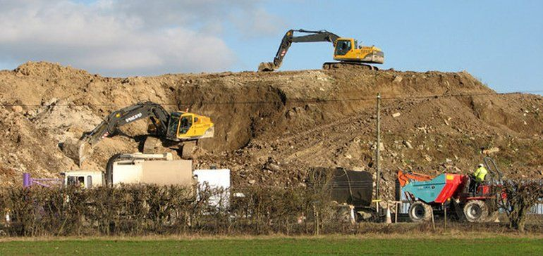 More trouble in Michigan: Contractor causes $500K in damage by dumping dirt at closed landfill | Waste Dive