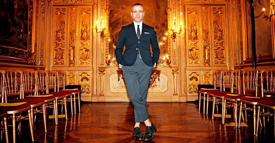 Fashion designer Thom Browne wearing his trademark suit with exposed ankles.
