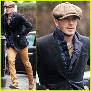 David Beckham donning a newsboy cap in chilly London!  9b5d7ffb8cd3