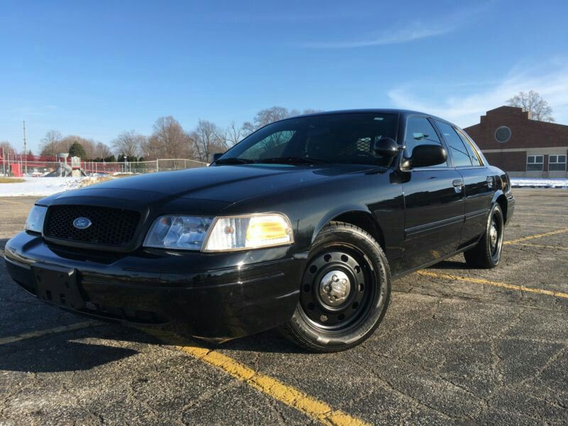 Black Crown Vic Victoria Police Interceptor Jeep Cherokee Sport