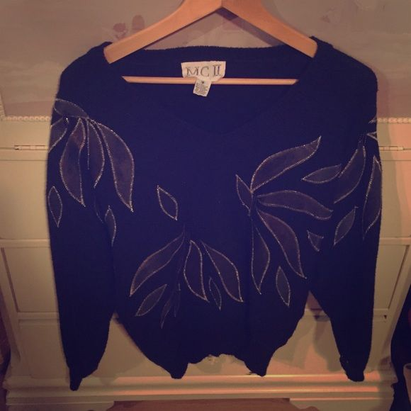 Vintage Black Sweater Brand is Mc II. I cant find a size but it fits a small/medium. Black with gold accents and beaded black frillies. Vintage piece  MC II Sweaters