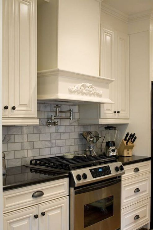 elegant kitchen with beaded raised front white cabinets paired with rh pinterest com