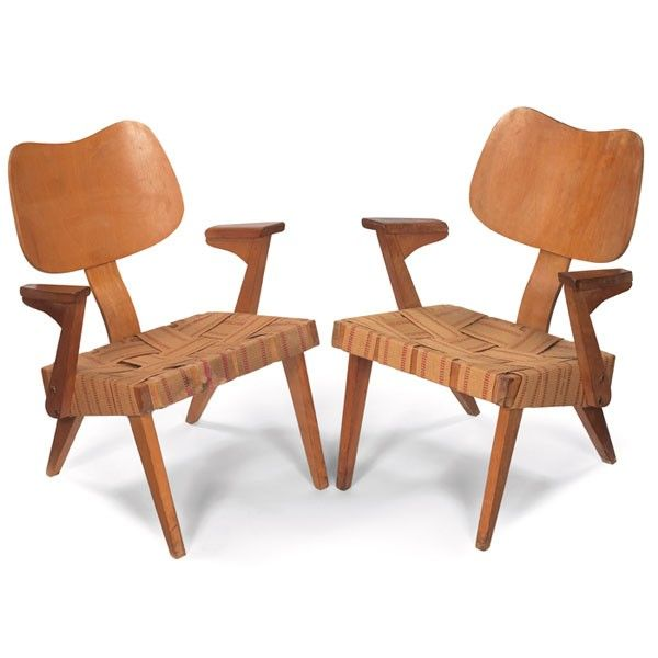 """Russell Spanner """"Ruspan"""" lounge chairs by Spanner Products, Toronto, Canada, c.1950 birch frames with flared legs, """"biomorphic"""" plywood backrests and woven strap seats."""