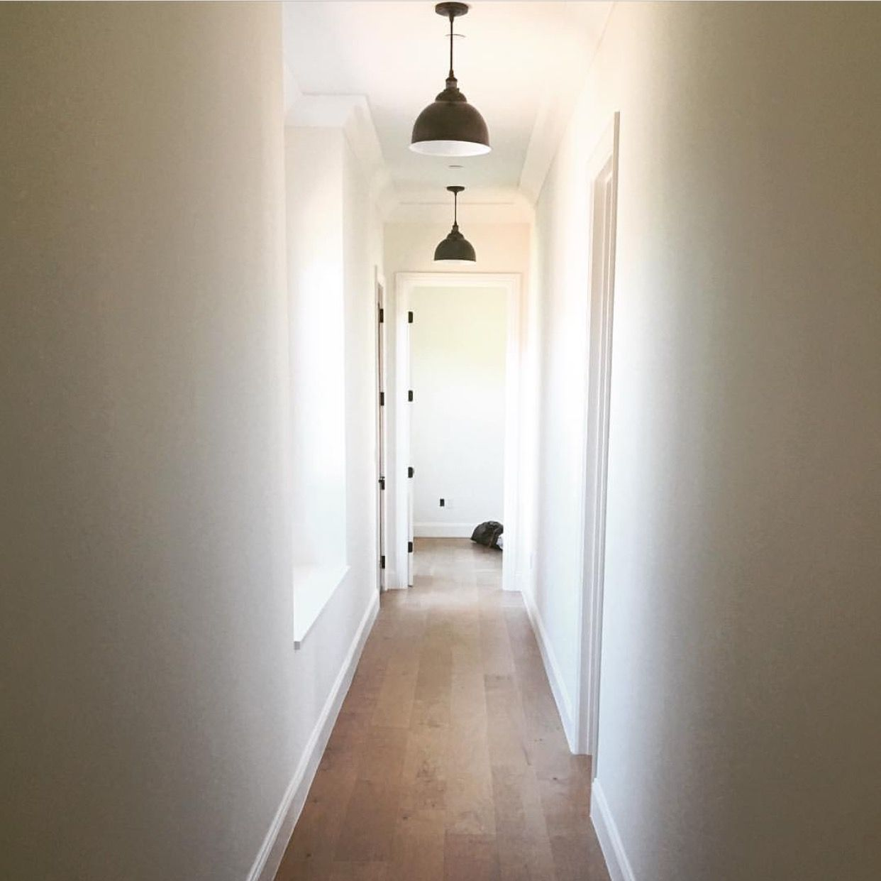 Hallway, white book and black accents