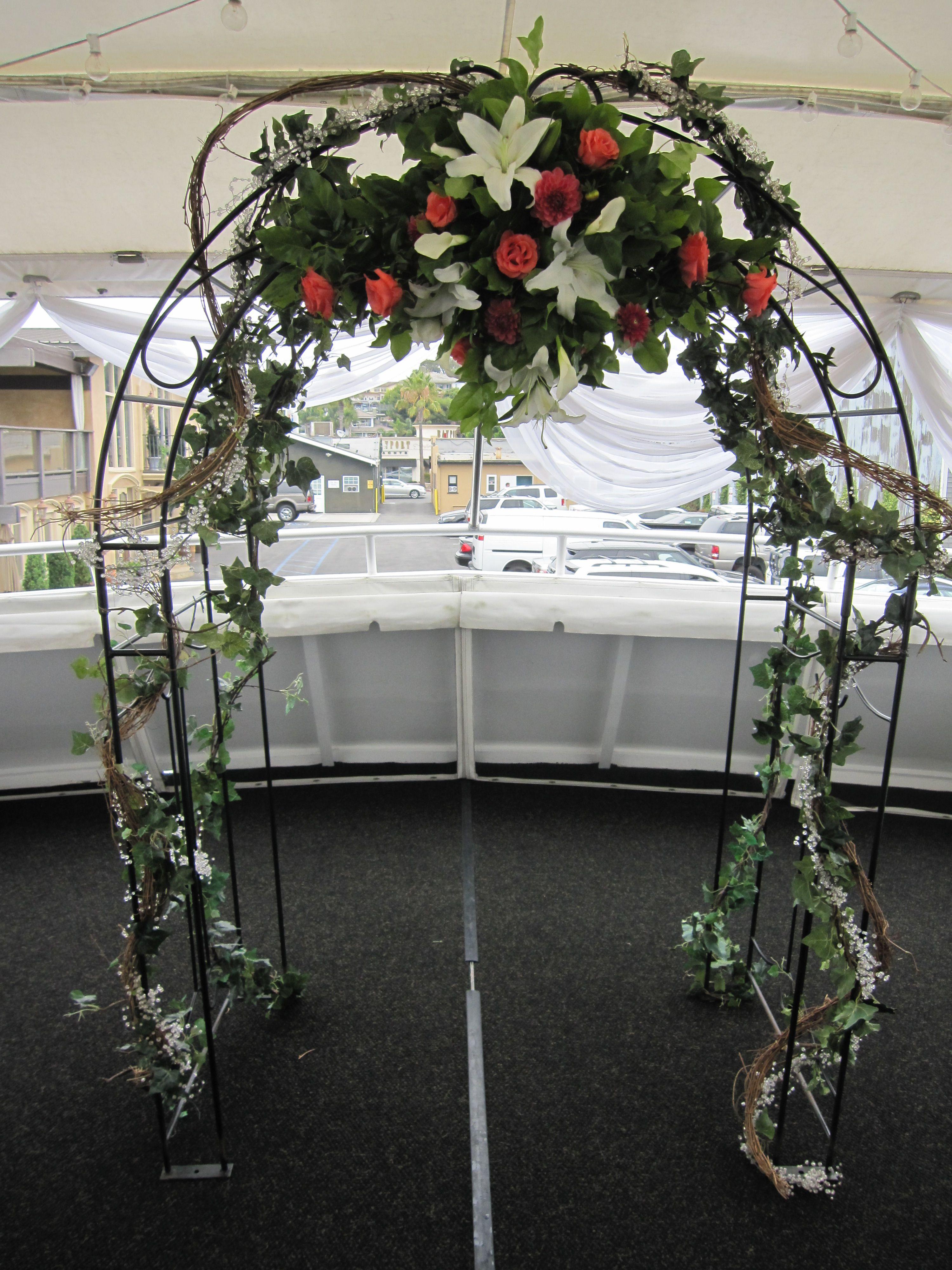 White and coral flowers on arch spray weddings events flowers by white and coral flowers on arch spray mightylinksfo