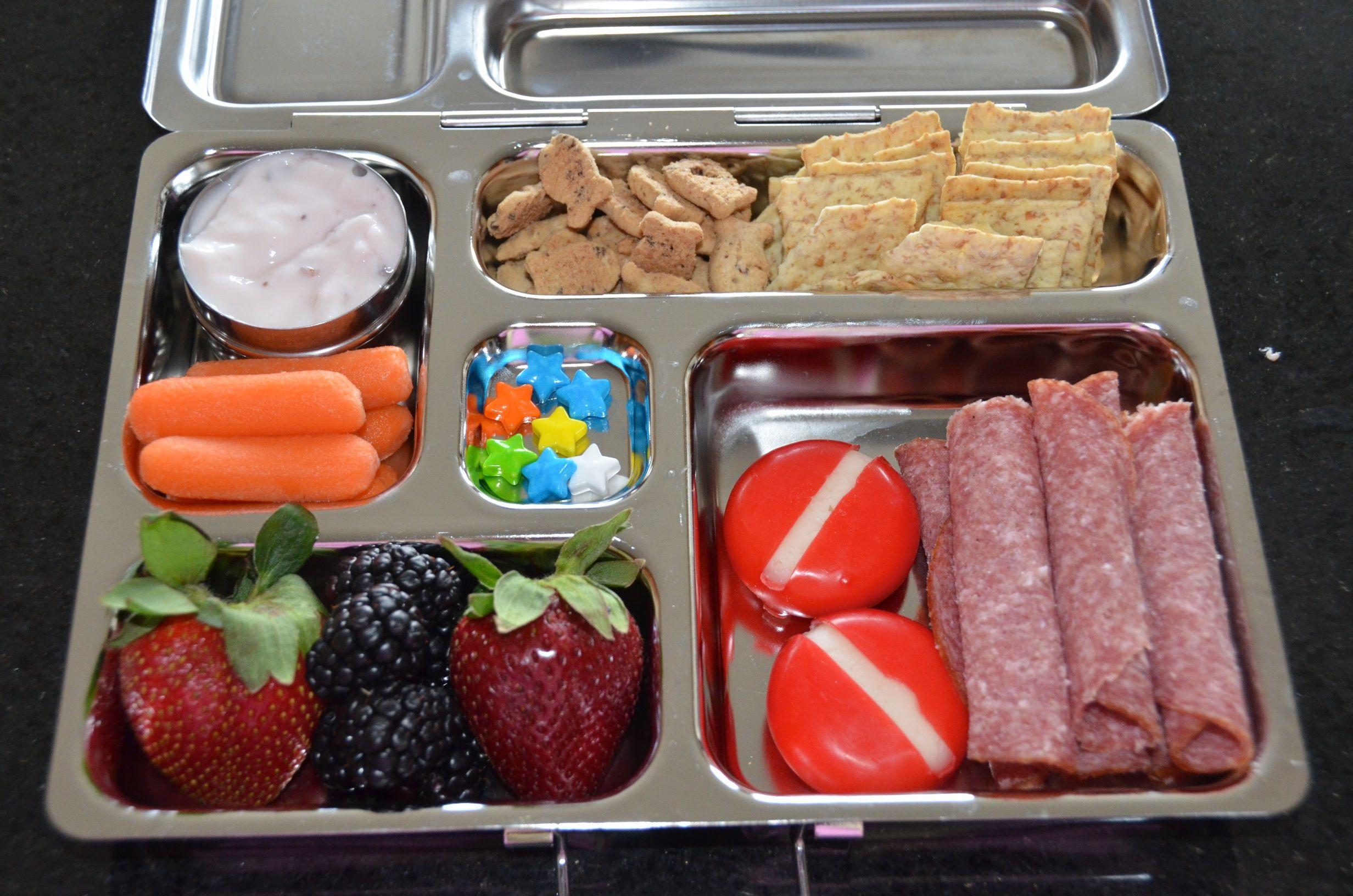 Yogurt, Carrots, strawberries, blackberries, babybel cheese, german salami, wheat thin crackers, chocolate chip goldfish, star candies