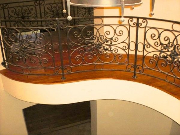 Superbe Curved Stair With A Custom Nosing Edge Matched To The Curve Of The Hall.