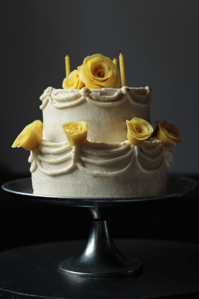 orange and chocolatechip cake with mascarpone frosting and maripan roses