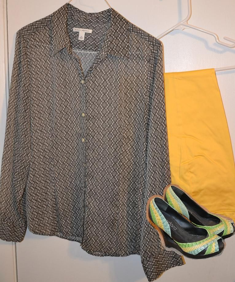 a patterned neutral top with yellow pants and multicolored shoes