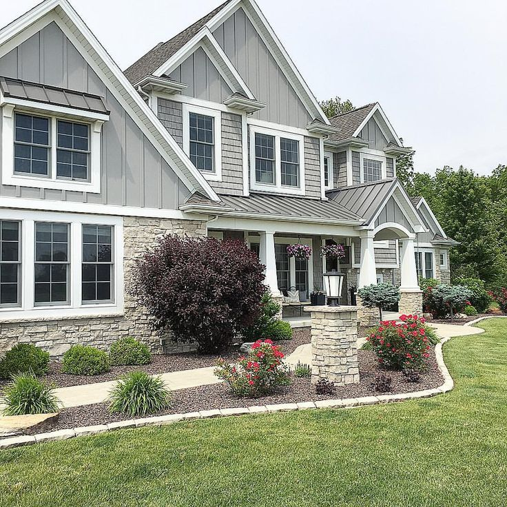 Grey Shingle style home Board and batten