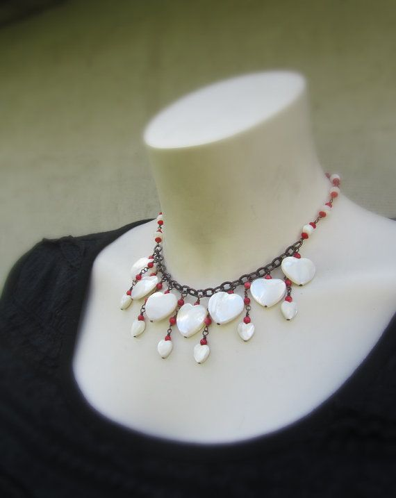 PURIFIED PASSION - Even white and pure heart can be touched by passion ❀ white shell heart bib necklace; ❀ made from white shell heart and smooth round beads, red coral beads and antiqued copper; ❀ lobster clasp; ❀ total length approx. 39.5 cm (15 1/2); ❀ has a closure extender approx. 7 cm long (2 3/4); ❀ you will get the exact item you see in the pictures; ❀ the necklace will arrive in beautifully wrapped box and ready for gift giving; ❀ if you have any question about the necklace...