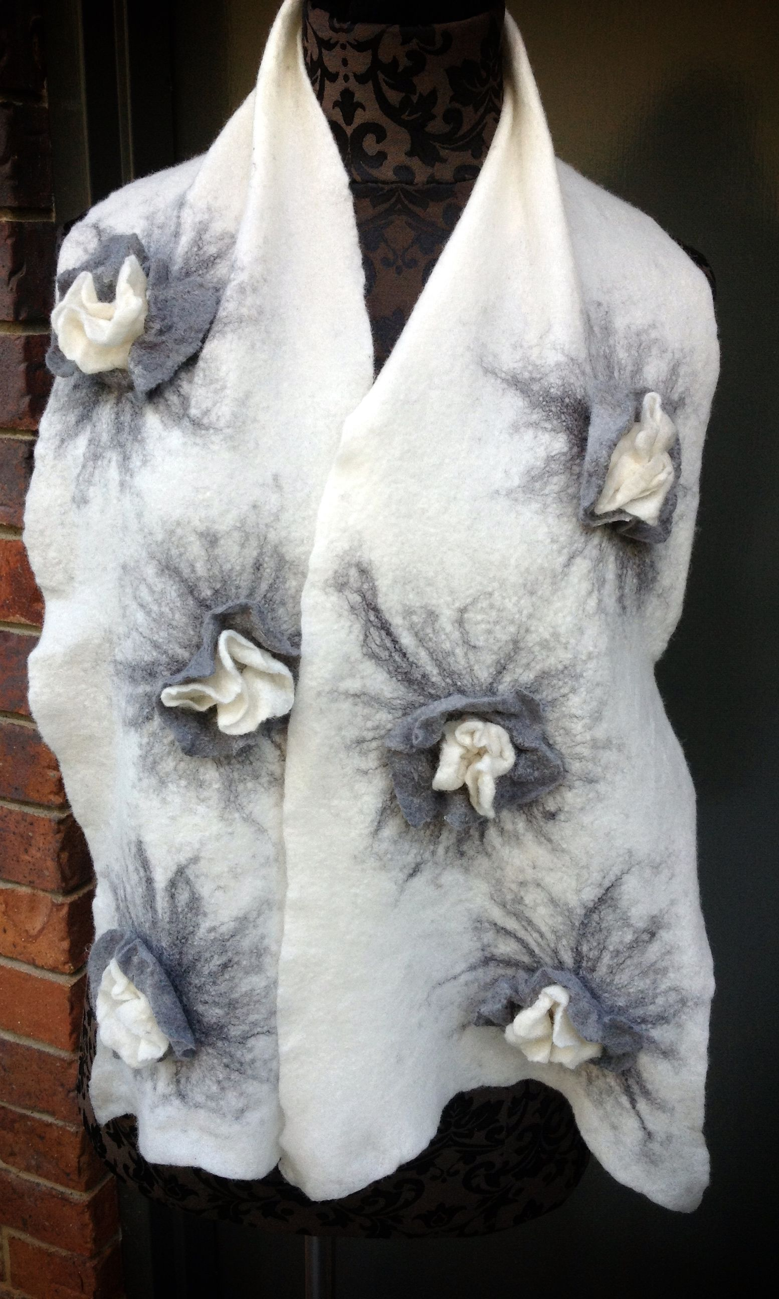 Hand felted scarf using 100% Australian merino wool and silk fibres featuring raised flowers