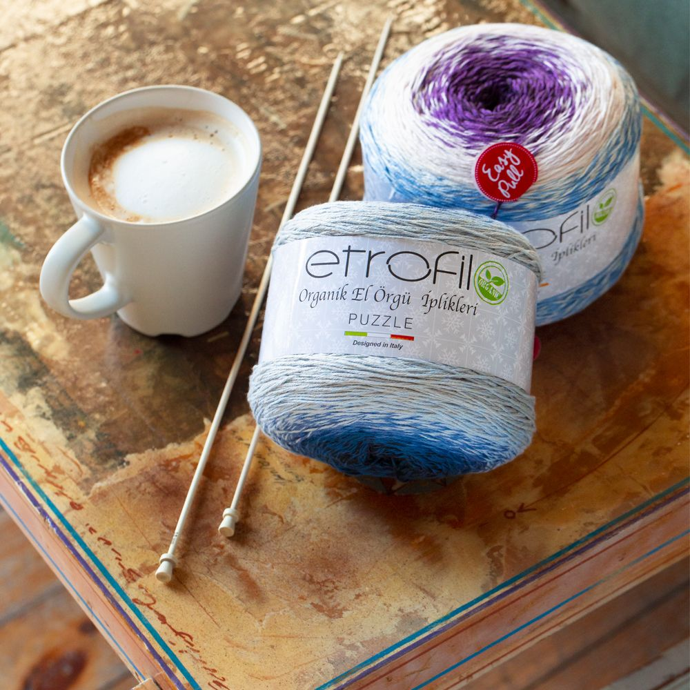 Etrofil Puzzle is a cake yarn consisting of 60 cotton and