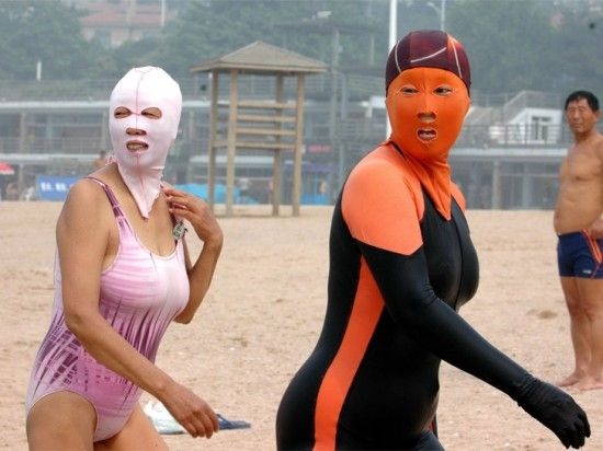 "facekini-- White skin is considered a sign of beauty in China, and the Chinese even have an old saying that translates as ""white skin covers up a hundred uglinesses.""     Facekini doesn't only shield its wearers from UV rays, it also repels other nuisances like jellyfish stings and sharks. One Taobao facekini vendor says the orange colored ones keep sharks away because ""they fear this color the most""."