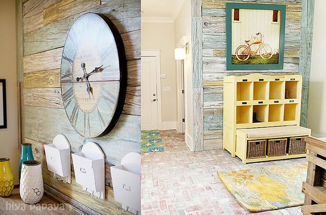 entry way-love the teal framed picture of bicycle and yellow bench/table under!