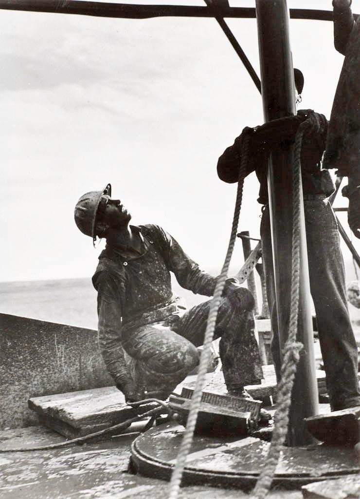 Old style oilfield work. Roughnecks in the '50s or