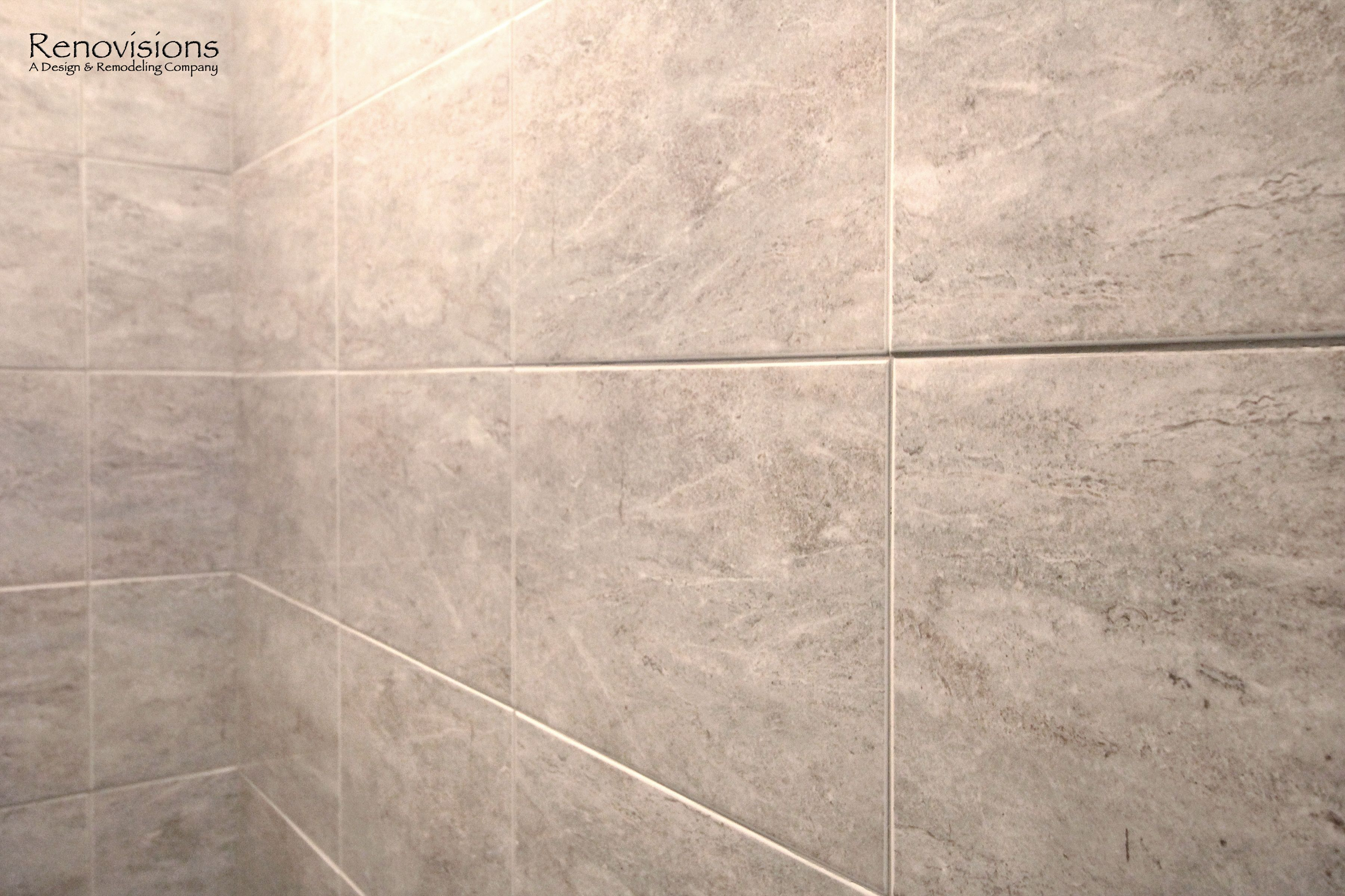 Bathroom remodel by Renovisions. Contemporary style, grey tile, tiled shower walls