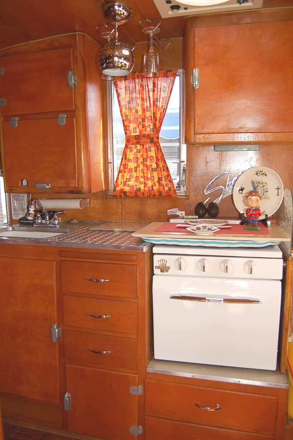 Picture of un-restored kitchen cabinets in 1955 Shasta Trailer ... on 1955 kitchen appliances, 1955 kitchen trim, refinishing oak cabinets, 1955 kitchen tiles, 1955 kitchen antiques, 1955 kitchen makeover, 1955 kitchen wallpaper, 1955 kitchen tables, 1955 kitchen stoves,