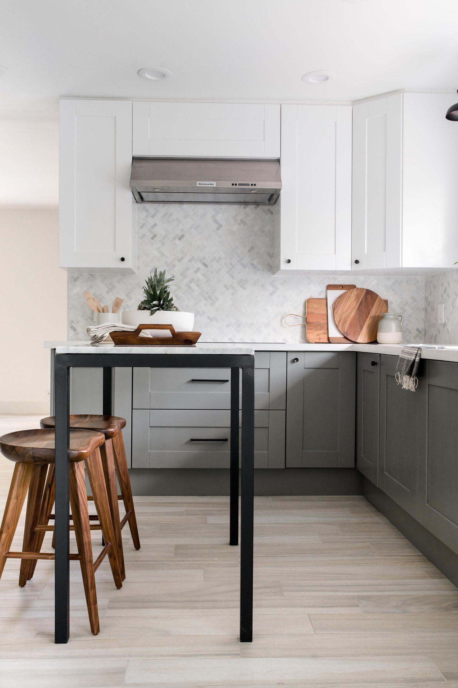 Modern Grey Kitchen White Upper Cabinets Marble Backsplash The Habitat Collective P Modern Grey Kitchen Residential Interior Design Interior Design Firms