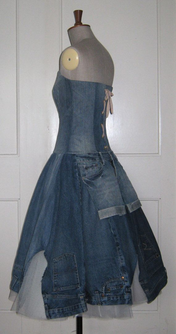 This unique dress has a paneled, fitted boned bodice and is made entirely from deconstructed jeans. The back of the bodice is laced and the skirt