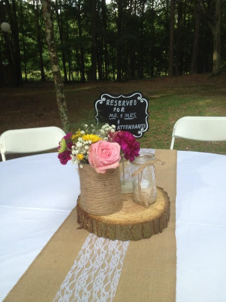 Burlap table runner a simple centerpiece with cut wood, chalk board, burlap or tulle jars with a small flower arrangement.