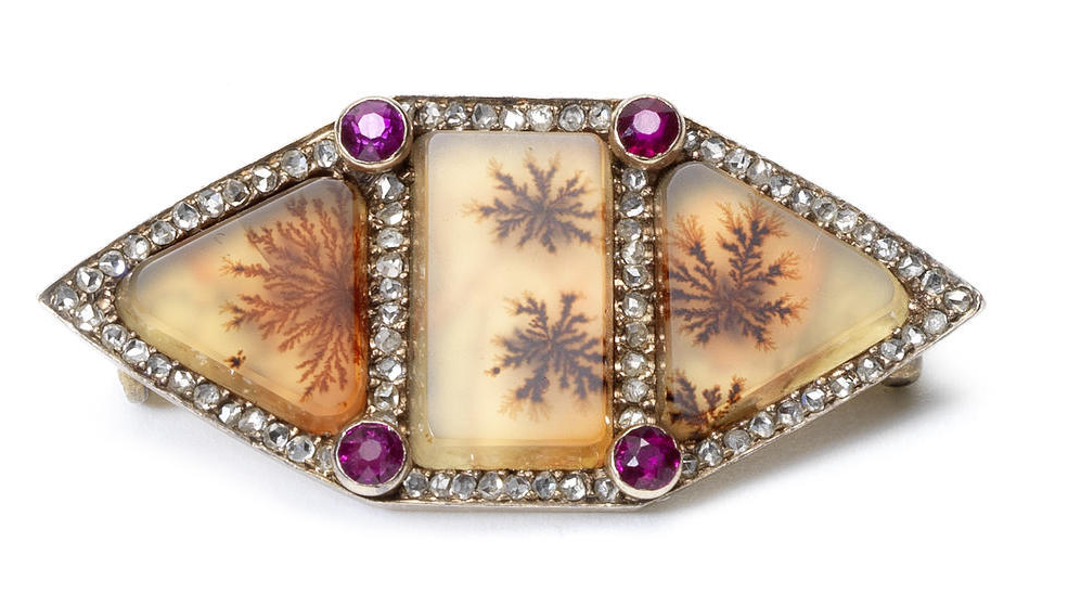A brooch of agate moss Fabergé, workmaster Michael Perchin, St. Petersburg, circa 1890. the hexagonal facade composed of three moss agate sections within rose-cut diamond borders set with rubies and gems
