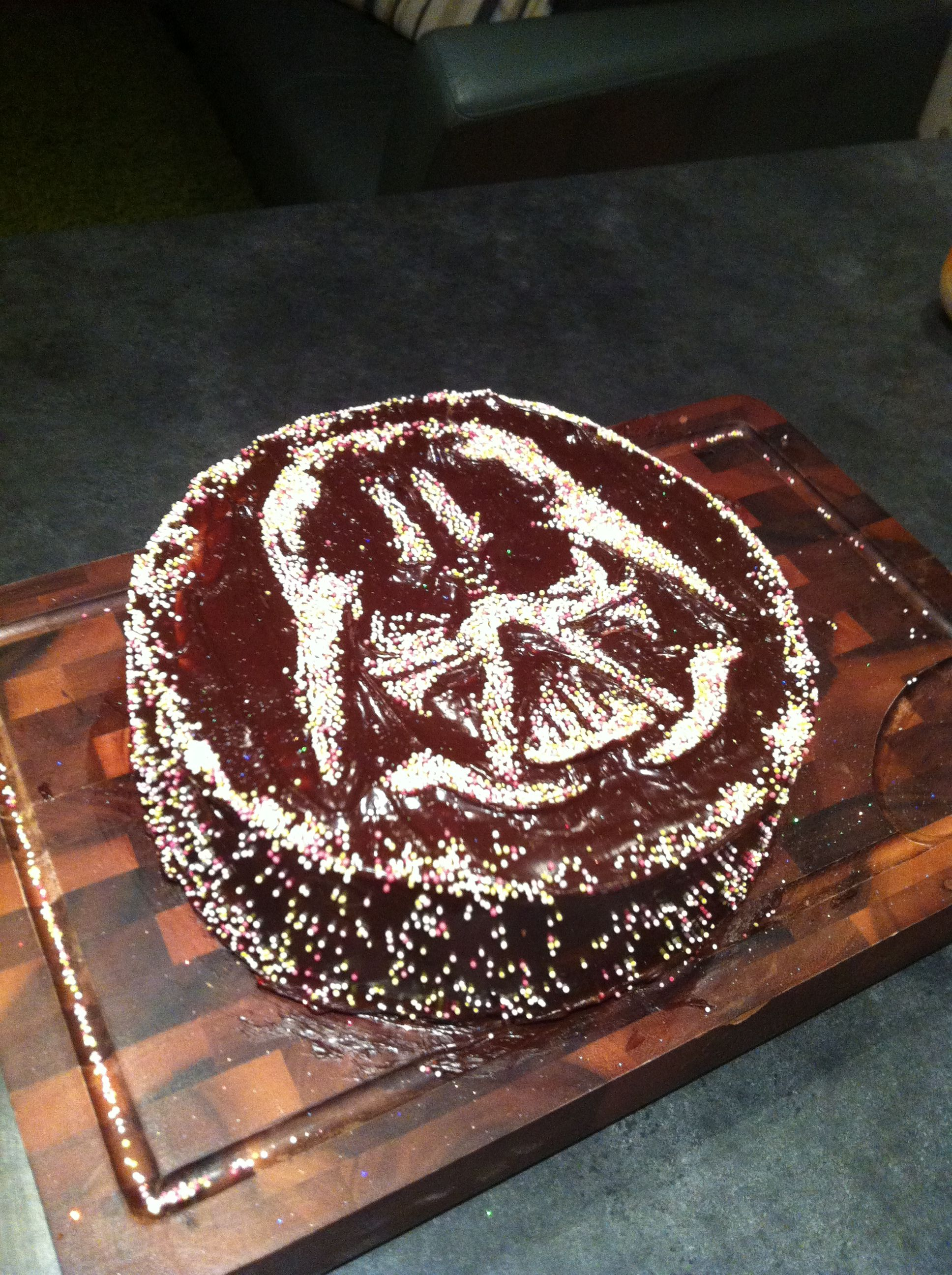 Darth Vader Chocolate Cake. Rich chocolate cake with a chocolate buttercream filling, covered in dark chocolate ganache, then sprinkled through a stencil I made! Easy (ish) to do and looked great for a Star Wars fan's birthday