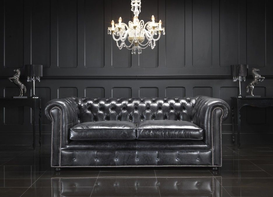 Furniture Living Room With Black Leather Chesterfield Sectional Sofa And Black Wooden Wall
