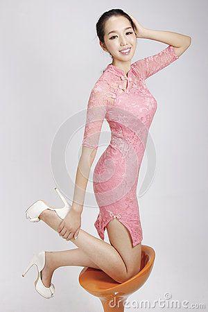Beautiful asian girl wearing pink chinese traditional dress.