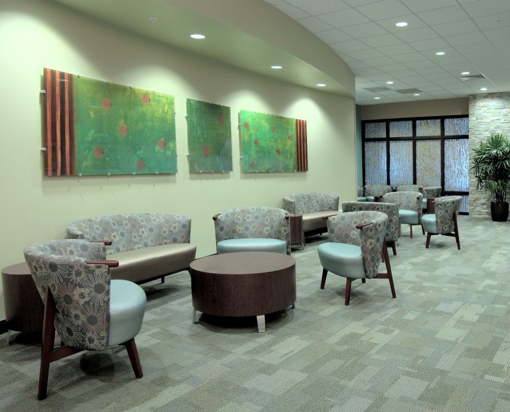 Medical office waiting room chair with flower pattern. # ...