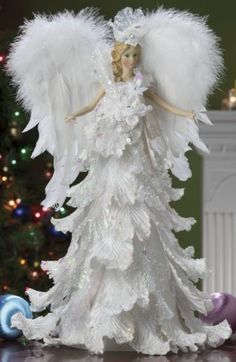 pin by kari harder morrow on christmas white decorated with a finger touch of an angel pinterest - Angel Topper For Christmas Tree