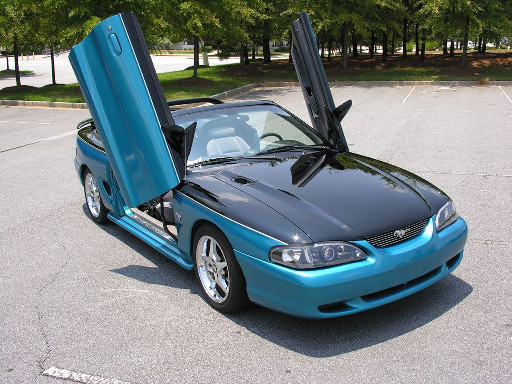 take this sn95 mustang convertible as a reminder that warm sunny days are coming soon it features vertical doors ch sn95 mustang mustang convertible mustang take this sn95 mustang convertible as a