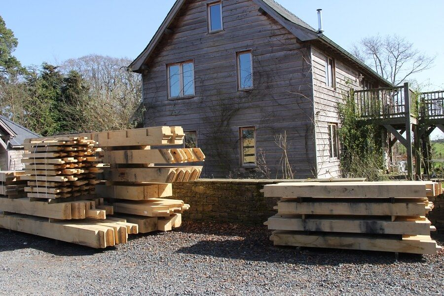Oak frame for a house in Carlisle all stacked up in the yard at Castle Ring Oak Frame #timberframe #woodwork