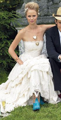 Amazing I love this dress not a huge fan of the blue boots Brides EyeletEyelet Wedding