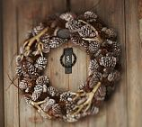 Making one from all the beautiful pine cones, feathers, and antlers at our Roberts Ranch Hunt Camp
