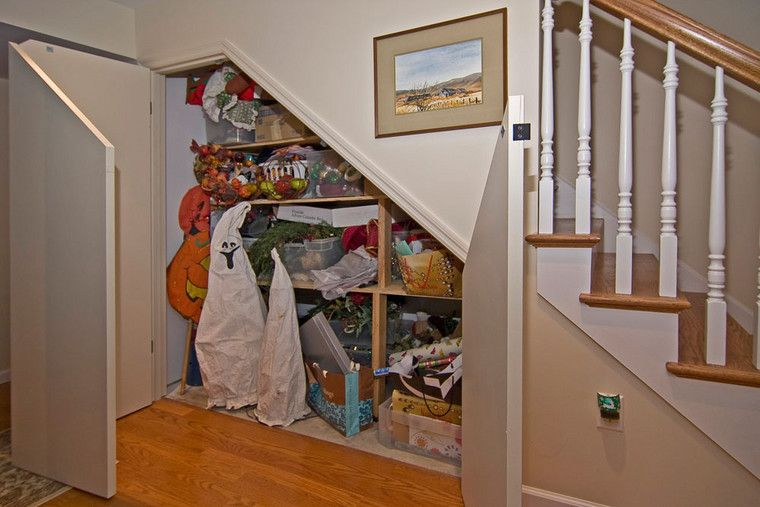 Under the stair sof their finished basement we created a uniquely shaped closet under the stairs - Finished basement storage ideas ...