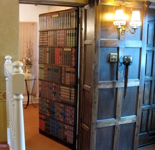Hidden door opens out, away from library. The books are fake.
