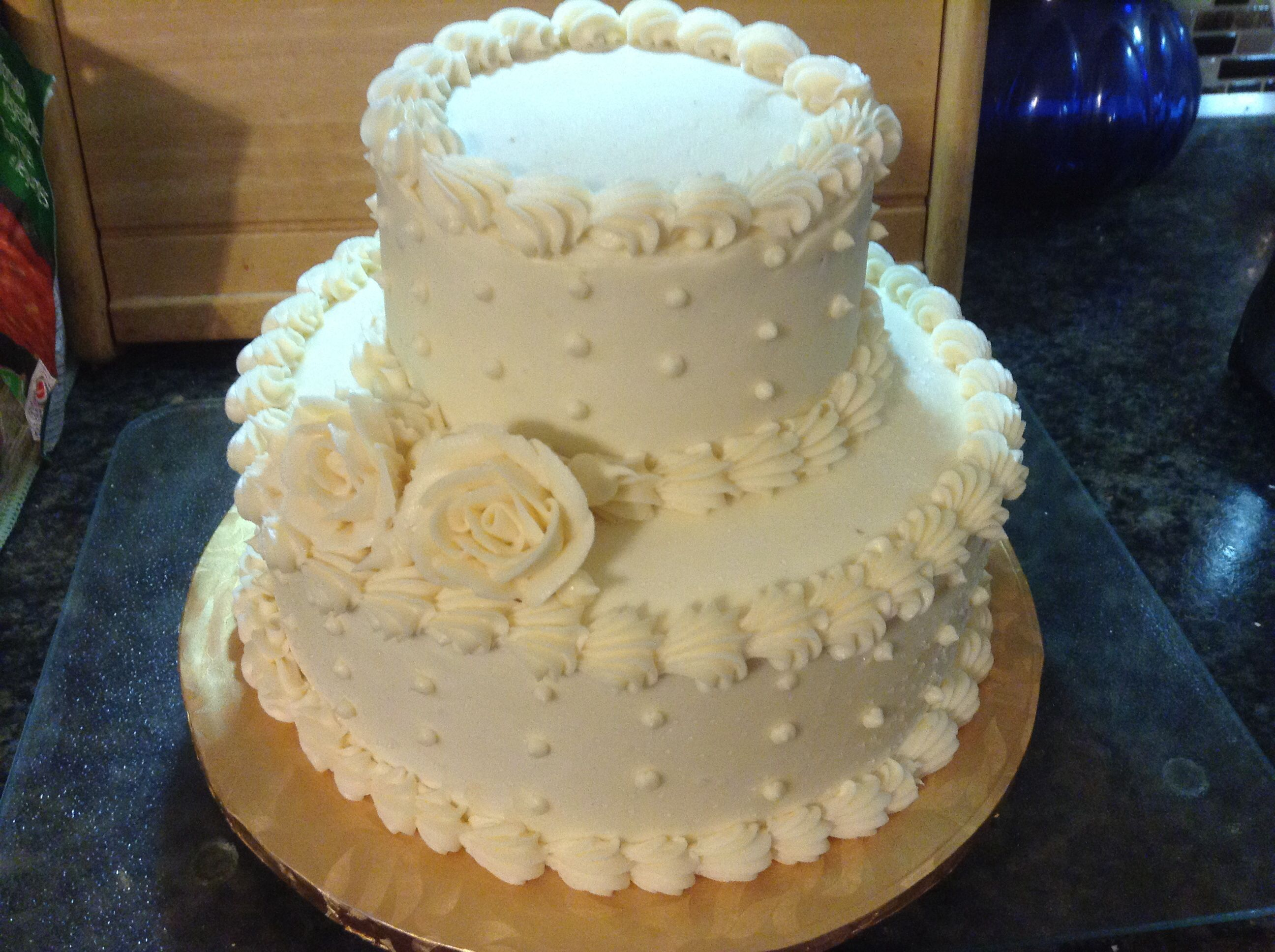 First attempt at a simple wedding cake. White sponge cake with ...