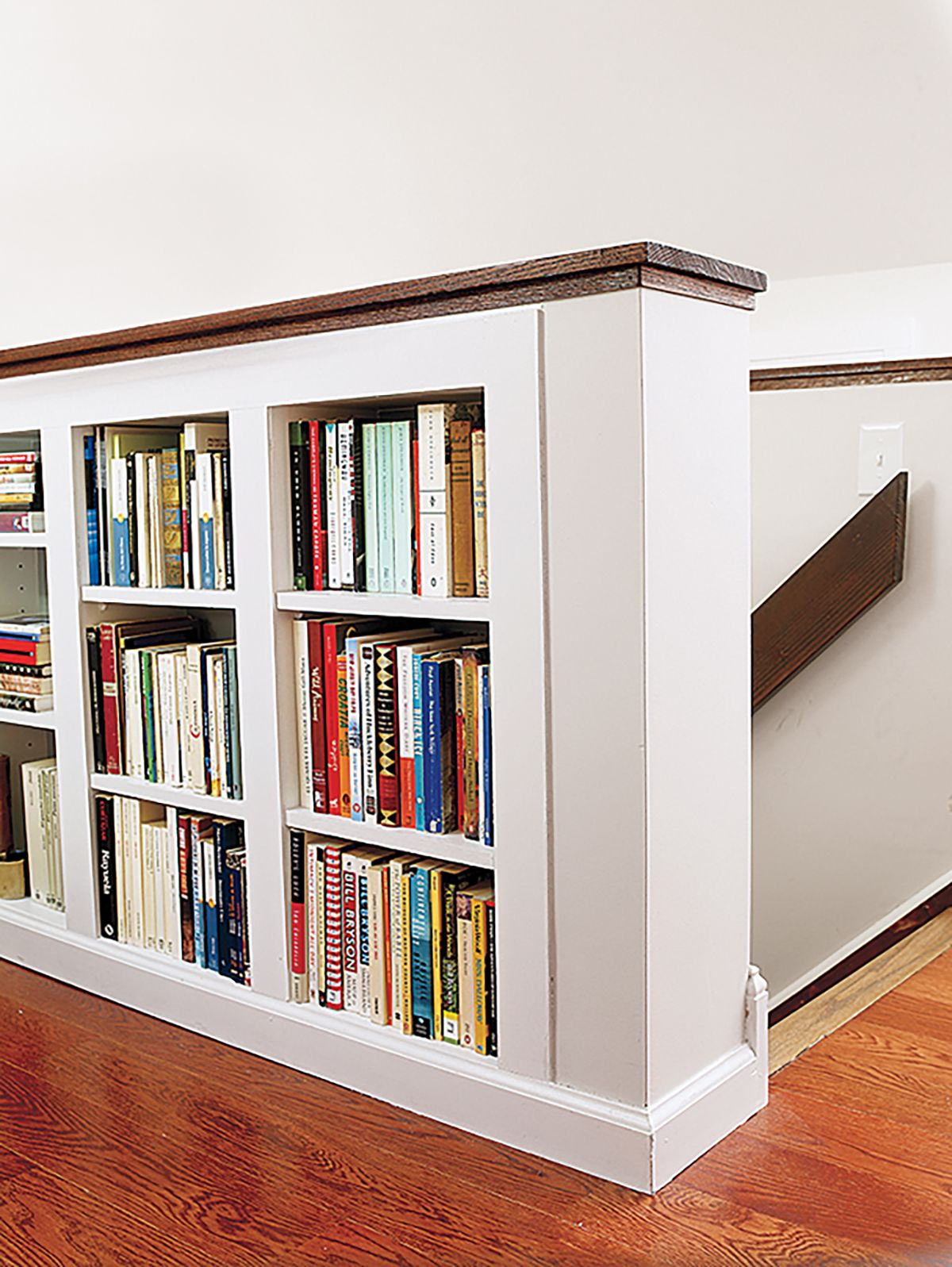 Look For Ways To Work Storage Into The Room S Interior Here A Half Wall Along Staircase Doubles As Bookshelf Next Home Office