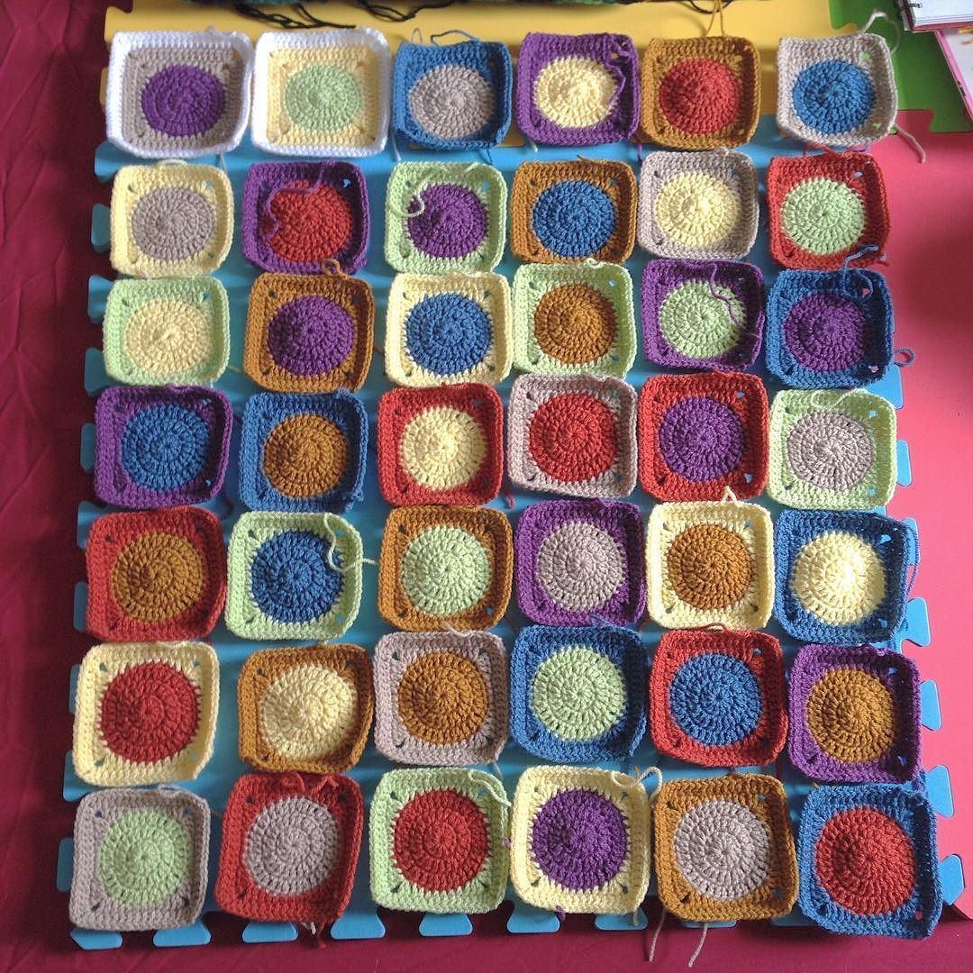 My latest wip is this gorgeous blanket! I even managed to make the squares random! That never happens! #crochetblanket #whatsonmyhook #crochet #grannysquareblanket by pinkrobotcrochet