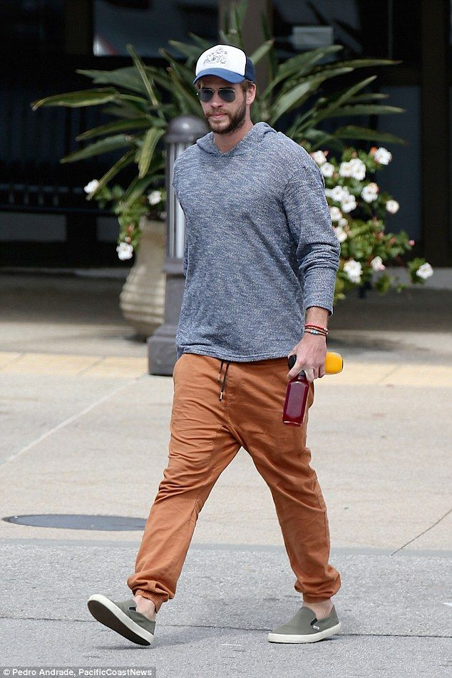 5dfbd8f8f67 Hat trick! Liam Hemsworth continued to keep his throwback haircut covered  with a trucker c.