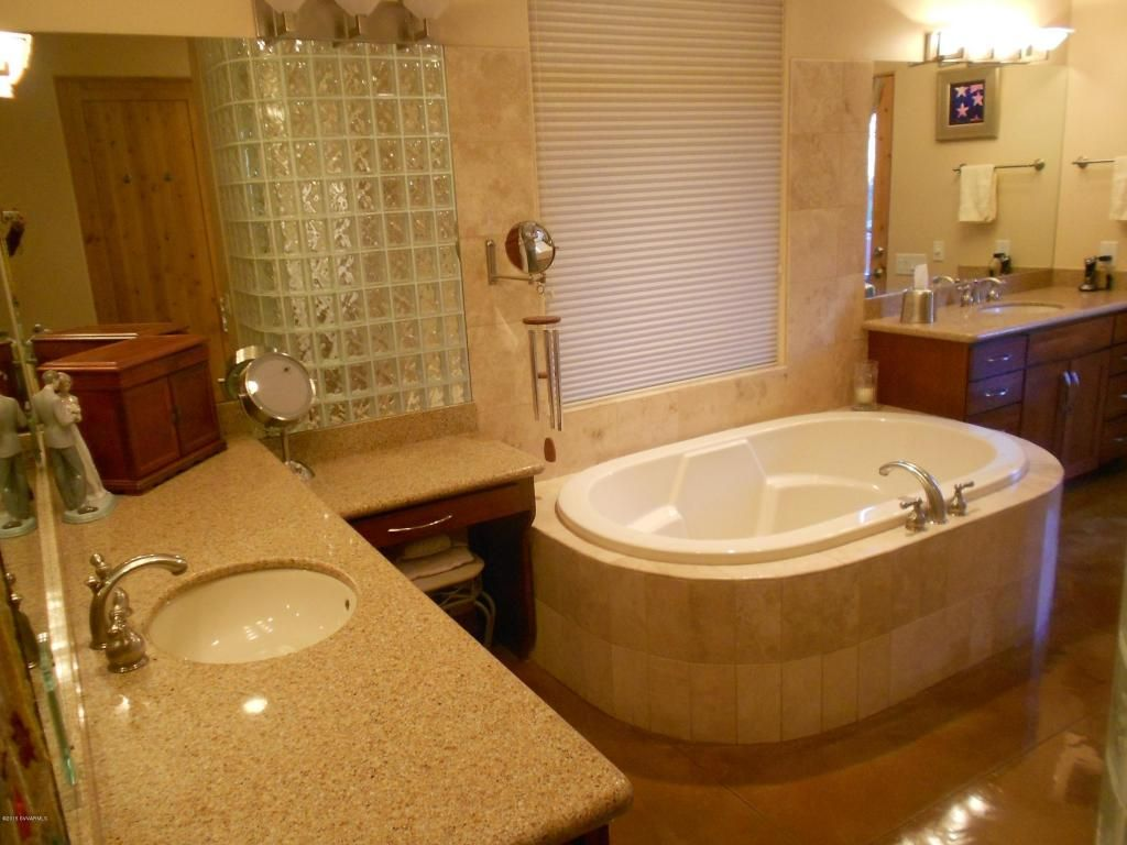 Separate Vanities with a Make-up area - Large Soaking Tub ...