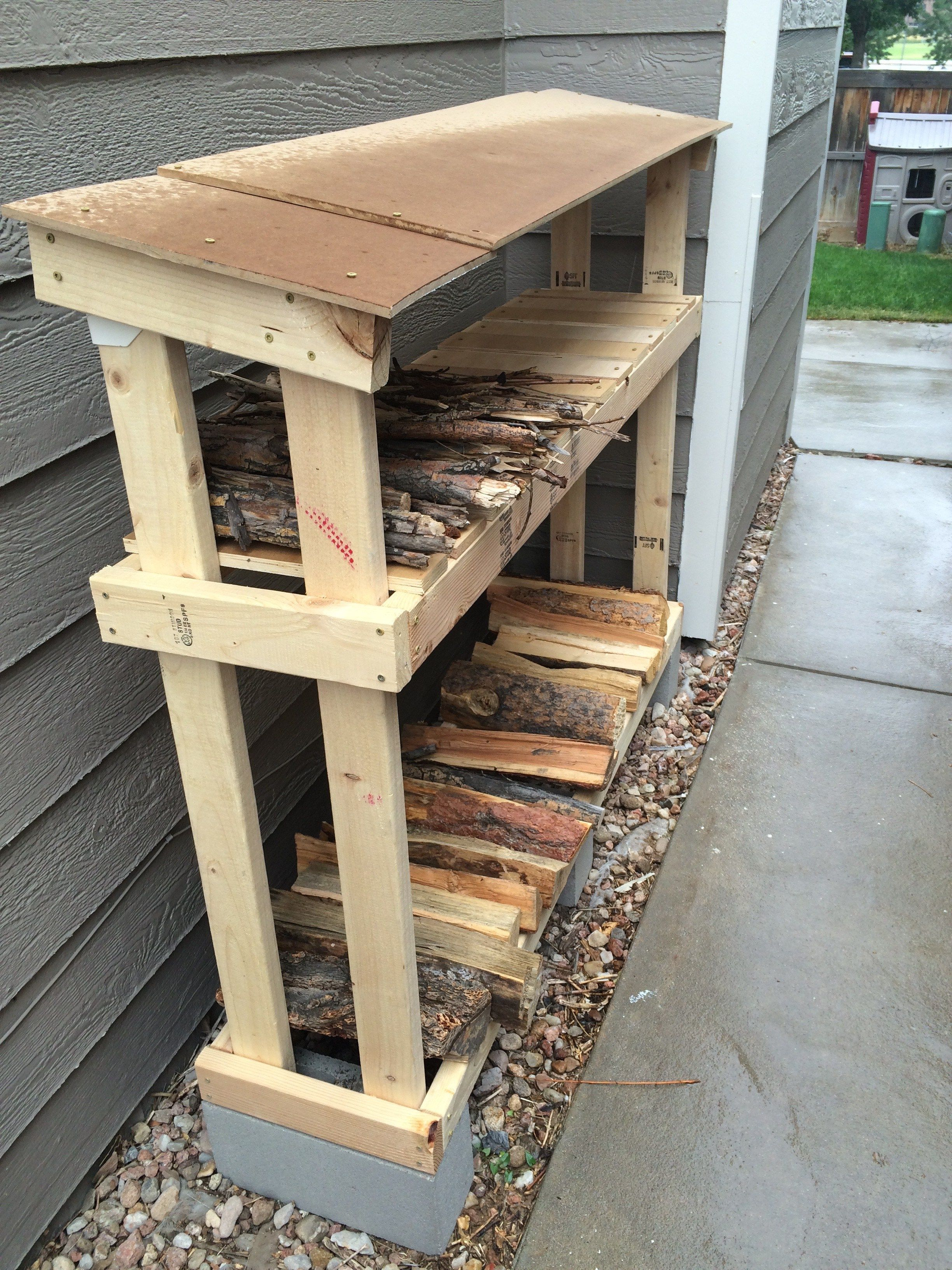 firewood storage that is easy to make and keeps wood dry and out of