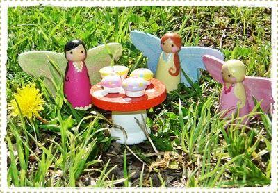 Felt wings on a peg doll