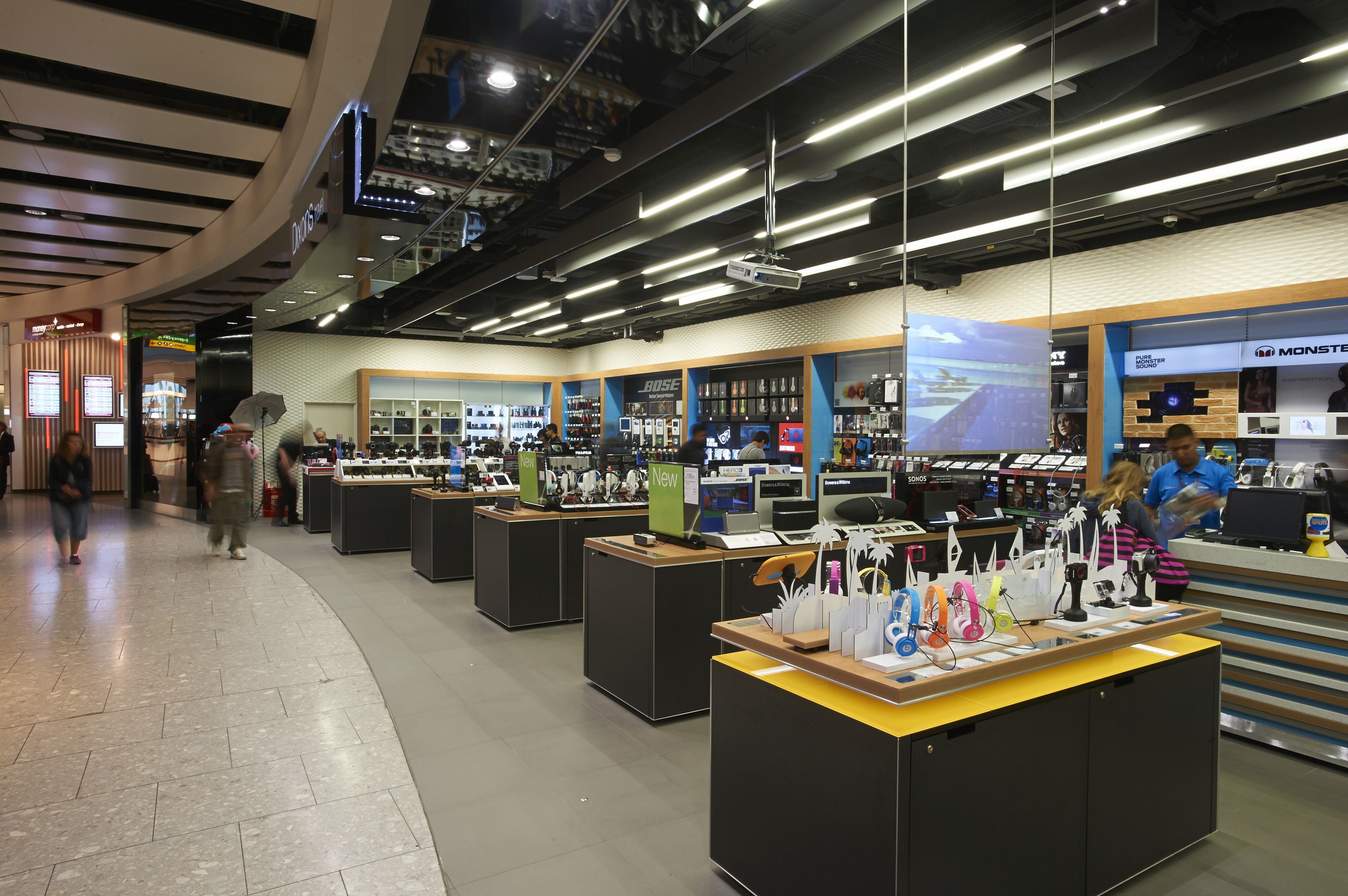 Retail Design | Shop Design | Electrical Store Interior | Inviting exterior / interior view of our new T5 Dixons Travel store. Playtables on wheels make for flexible retail space