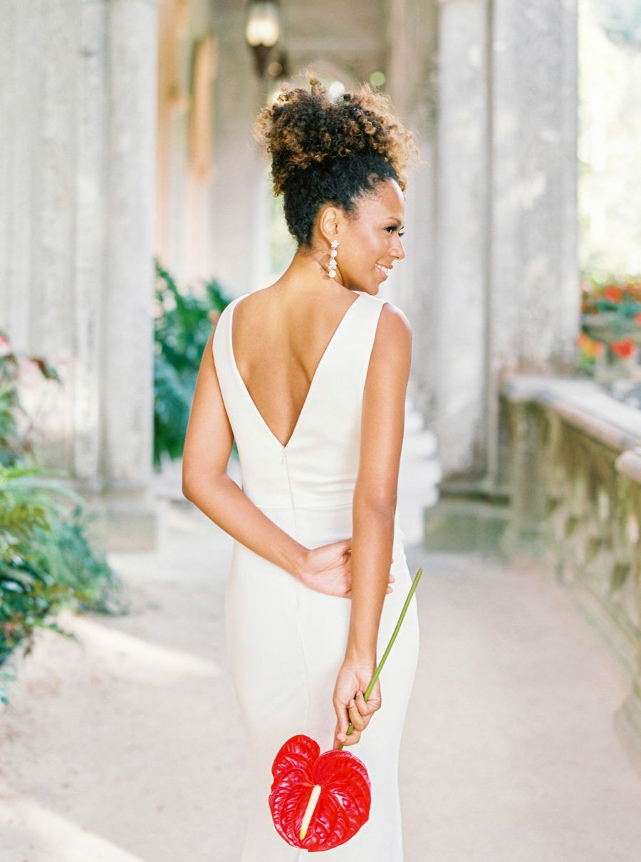 Very elegant bride in simple white dress with open back and single
