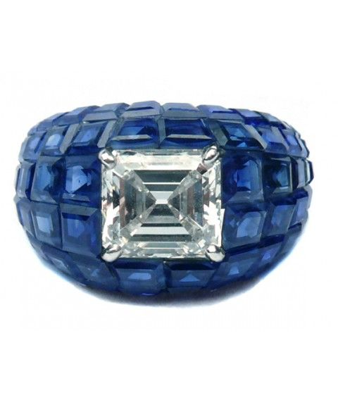VAN CLEEF & ARPELS Mystery Set Sapphire and Diamond Ring.